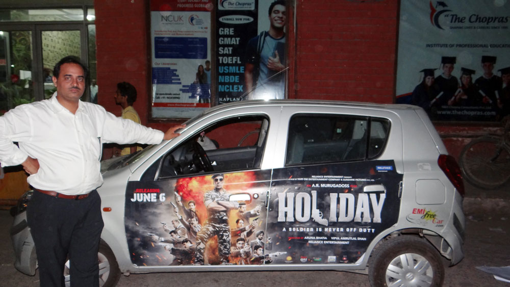 Akshay Kumar's Holiday emifreecar.com, holiday movie car advertisement in New Delhi